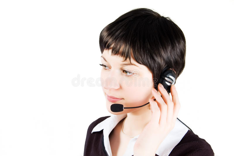 Customer support girl in call center. With headphones and microphone. Carefully listening royalty free stock photography