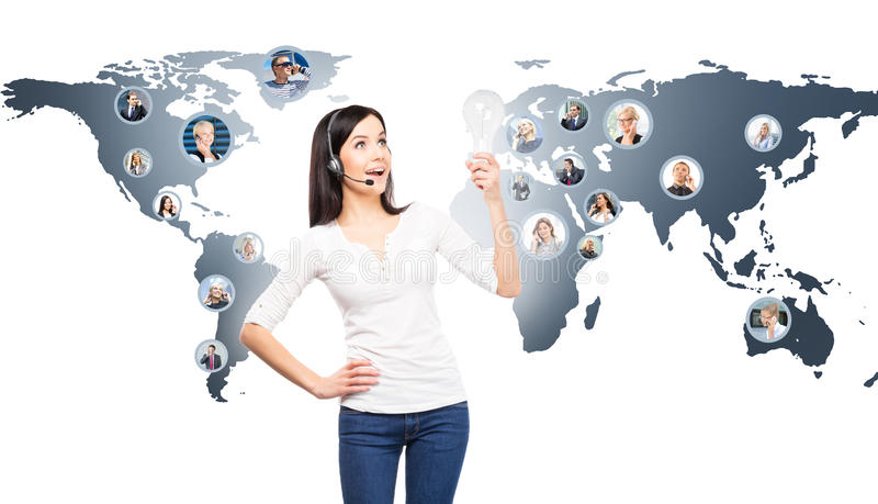 Customer support operator working in a call center office. Global business concept. World map with a businesspeople talking to ph royalty free stock photography