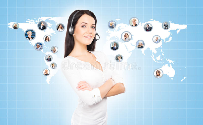 Customer support operator working in a call center office. Global business concept. World map with a businesspeople talking to ph royalty free stock photos