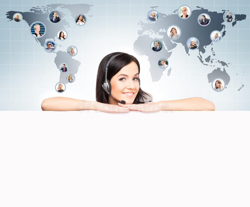 Call center operator working in a hot line office. Customer support and a global business concept. World map with royalty free stock photography