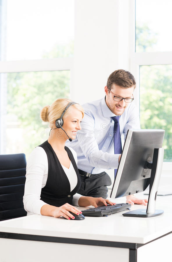 Customer support operators in formalwear working in a call center stock photos