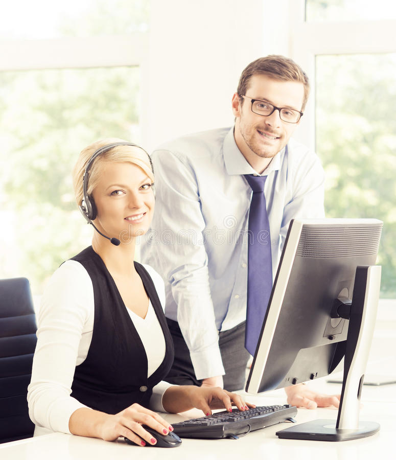 Customer support operators in formalwear working in call center royalty free stock photography