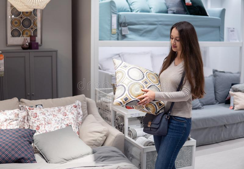 Customer woman buying new furniture - sofa or couch in a store. Supermarket mall store stock image