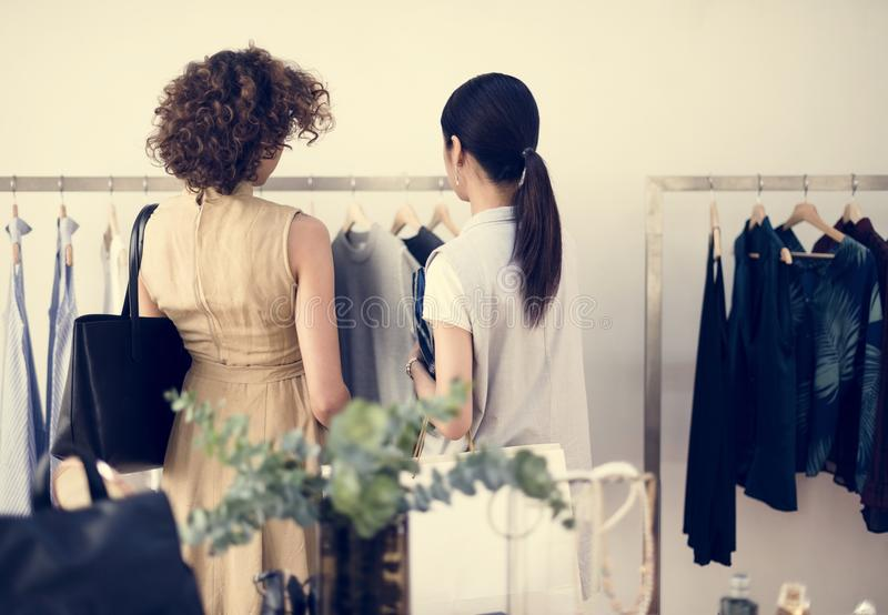 Customers checking out the shop royalty free stock photo