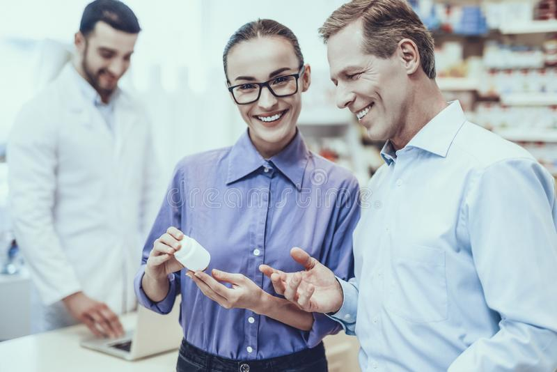 Man and woman buys a medicaments in pharmacy royalty free stock photo