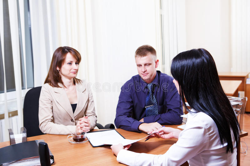 Customers discussing contract. Issues with their consultant royalty free stock photos