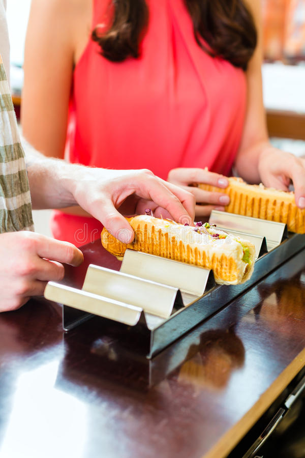 Customers eating Hotdog in fast food snack bar stock image