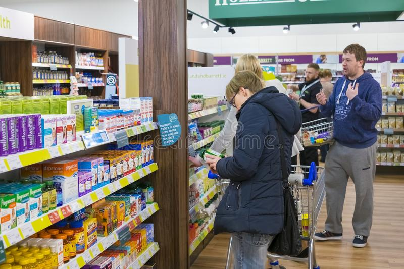 People in a Holland and Barrett Store stock images