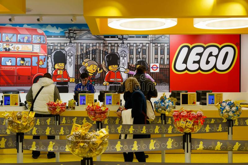 Customers in LEGO Store in London. London, UK - November 22, 2016 - Customers queuing to check out in the worlds largest LEGO store, newly opened in Leicester royalty free stock images