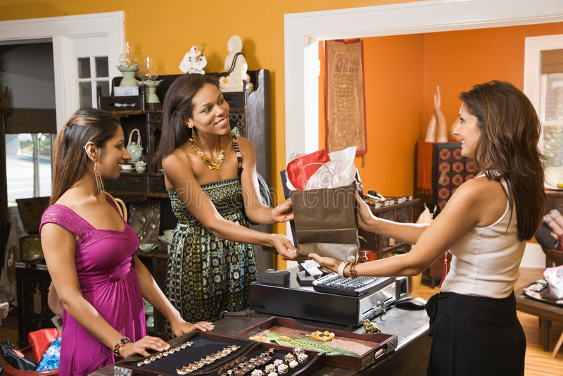 Customers making purchase. stock image