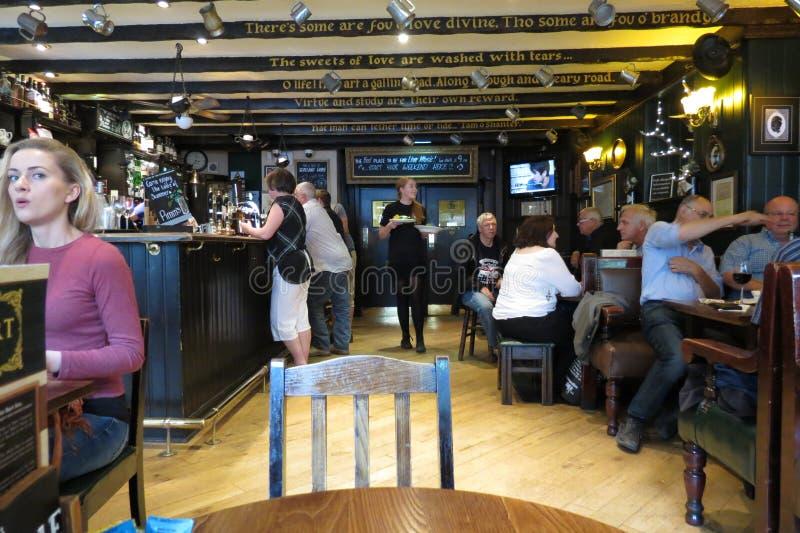 Customers in a pub in Edinburgh royalty free stock photo