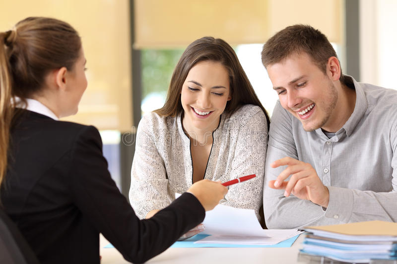 Customers ready to sign a contract at office stock image