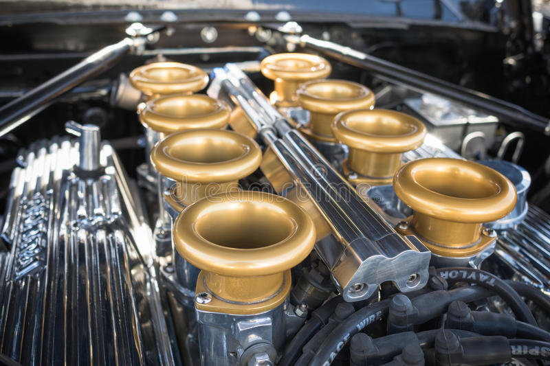 Customized muscle car engine displayed. Pomona, USA - March 12, 2016: Customized muscle car engine displayed during 3rd Annual Street Machine and Muscle Car royalty free stock photos