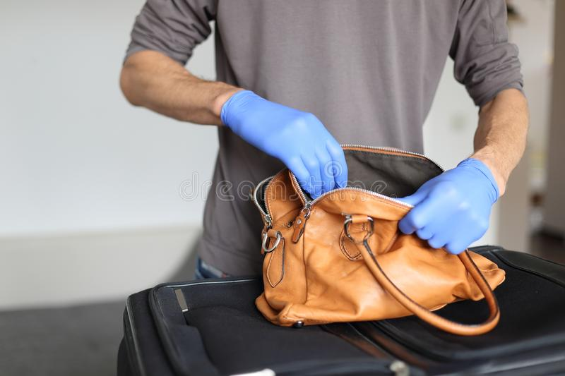 Customs at airport doing security check of hand baggage. A Customs at airport doing security check of hand baggage royalty free stock images