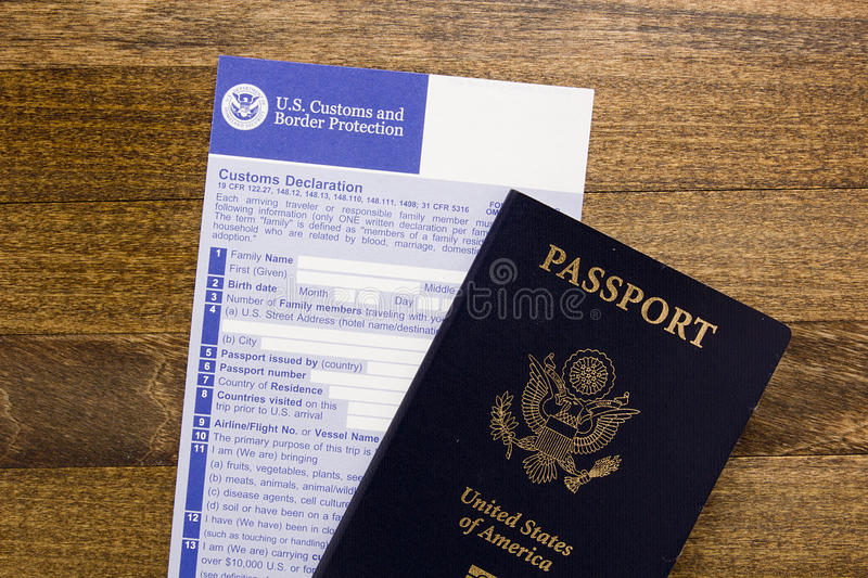 Customs declaration and passport. Customs declaration form with a passport, visa preparation passage control stock photo