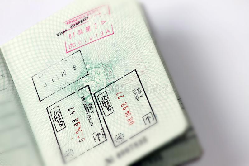 Customs stamps in international passport for traveling around the World. Document for traveling. Stamps and visas. stock image