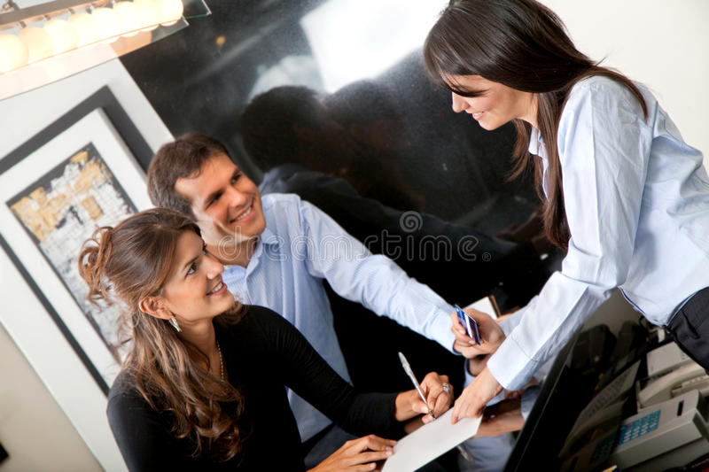 Download Custumers Paying At The Hotel Stock Photo - Image of businesspeople, card: 13188194