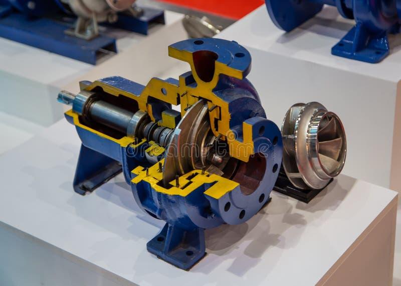 Cut-away centrifugal blue pump. Cut-away show cross section of industry centrifugal blue pump stock image