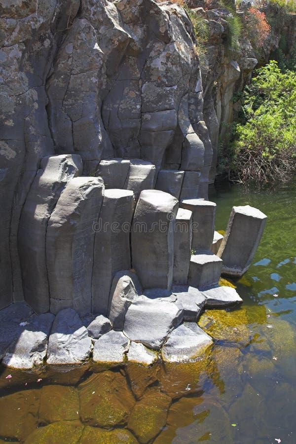 Cut basalt walls stock images