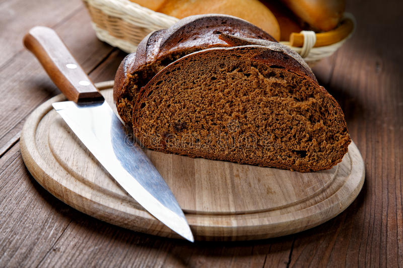 The cut black bread on a table royalty free stock photo