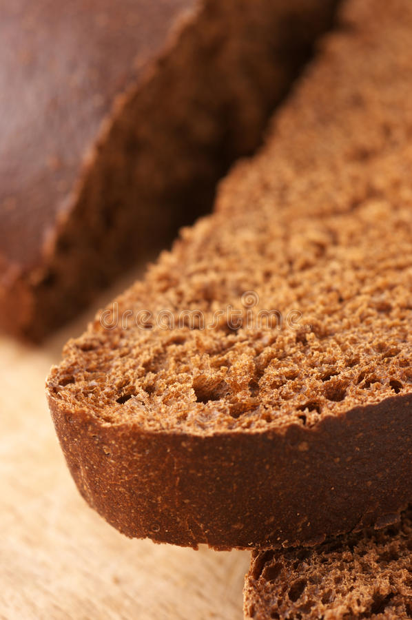 Cut bread close-up stock images