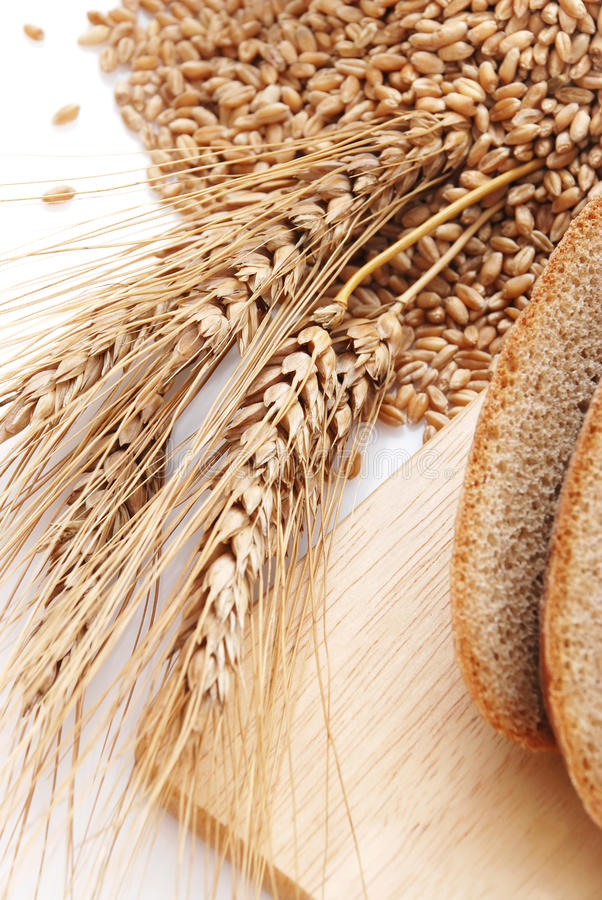 Cut bread and wheat stock images