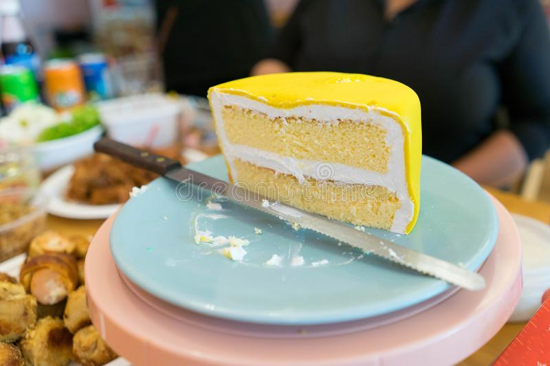 Cut cake show layer. Cake cut for show in cream layer with knife on blu plate royalty free stock photos