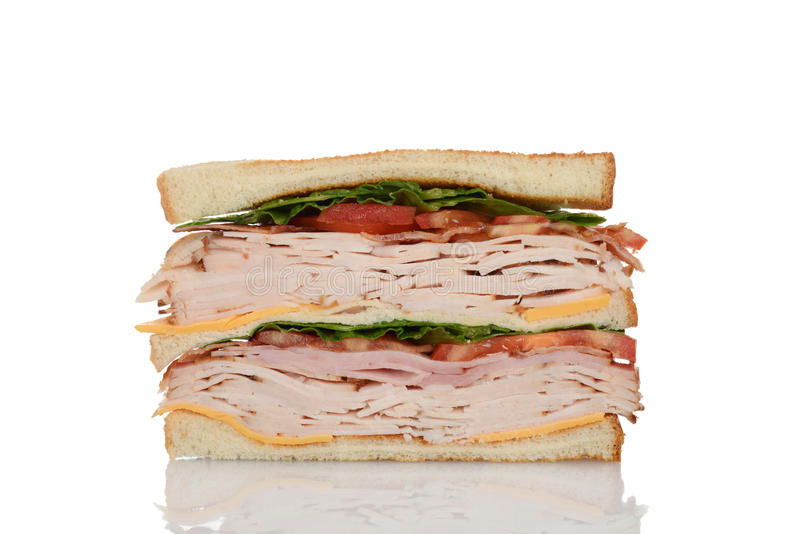 Cut chicken club sandwich. With white background stock images
