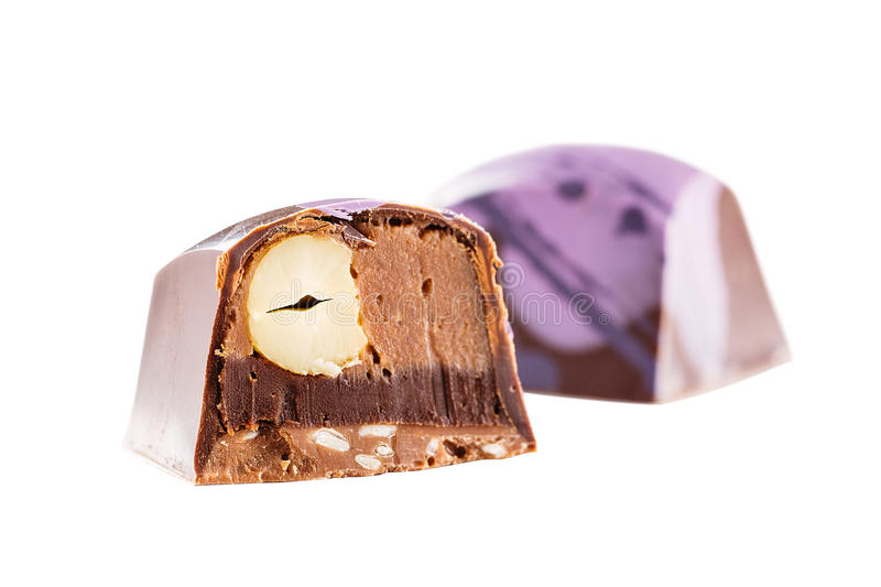 Cut chocolate candy with hazelnut royalty free stock photography