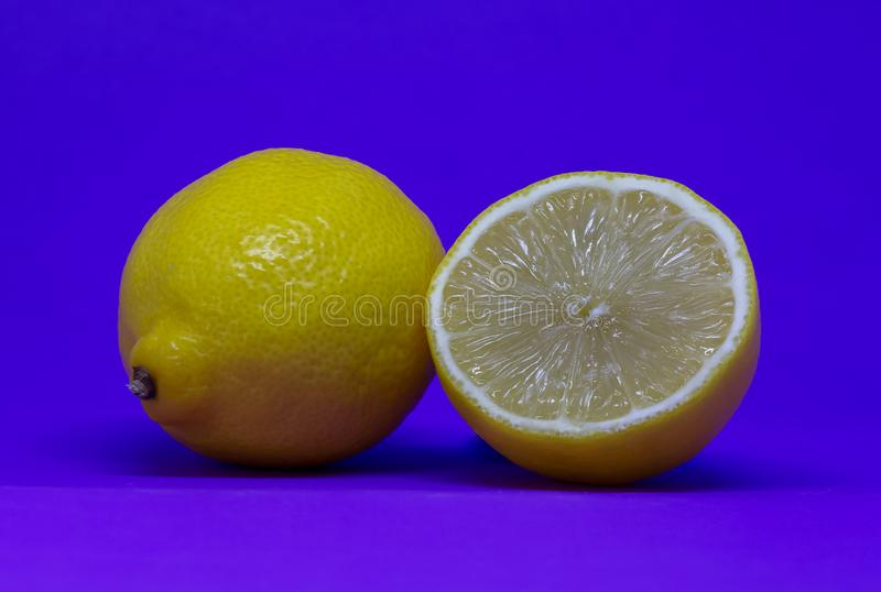 Cut citrus fruit isolated in a blue background stock image