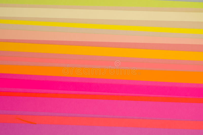 Cut Colored Paper Striped Pattern. Multiple exposure photograph of strips of colored paper, overlapping and creating an unusual striped pattern royalty free stock image