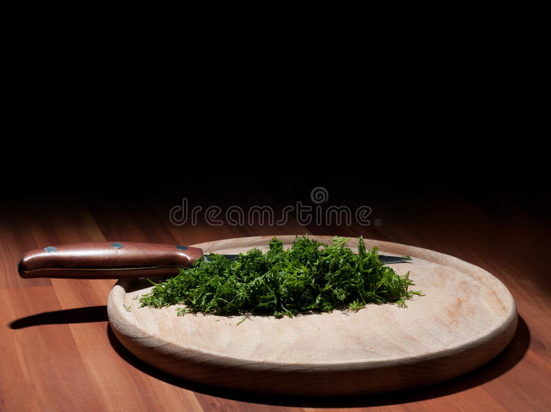 Cut dill. On a wooden table stock images