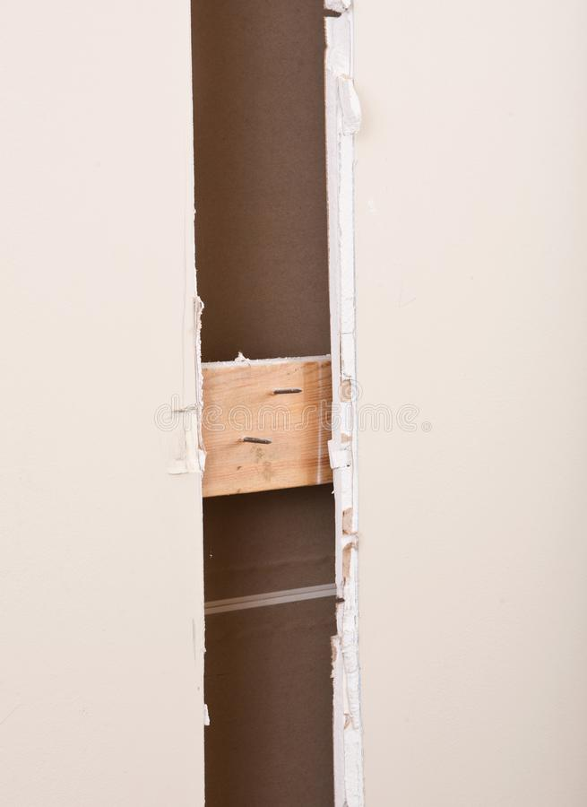 Cut drywall off wall in house. Under remodeling stock photos