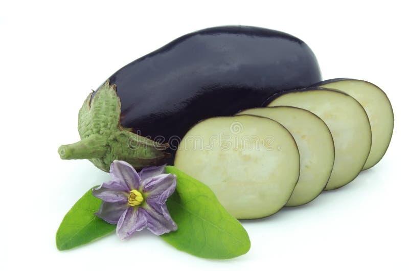Cut eggplants. Ripe eggplants and cut eggplants with flower on white background stock photo