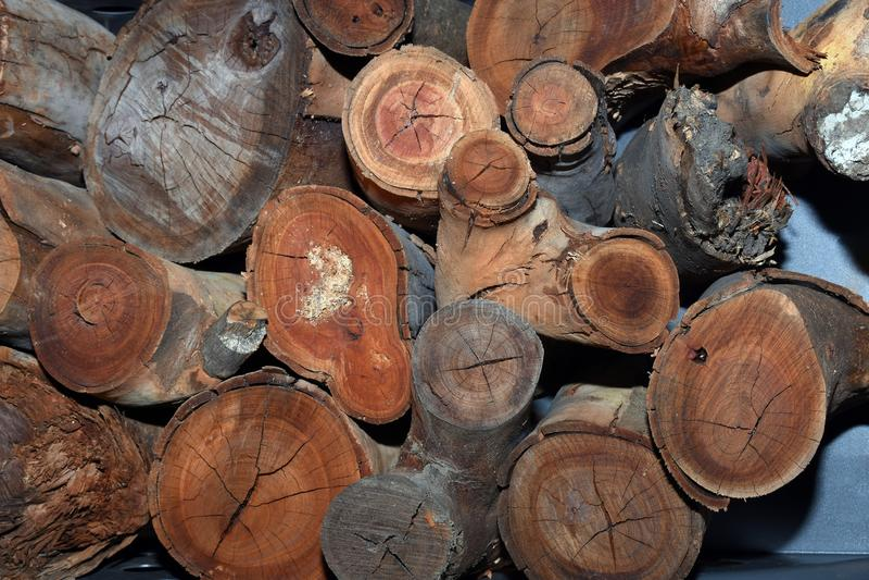 Closeup of a sawn firewood stack. Cut firewood timber pile closeup background stock photo