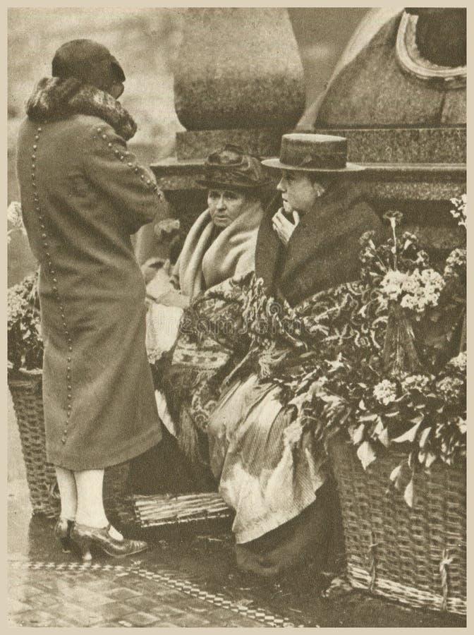 cut flowers are on sale as a sign of feminine custom stock photos