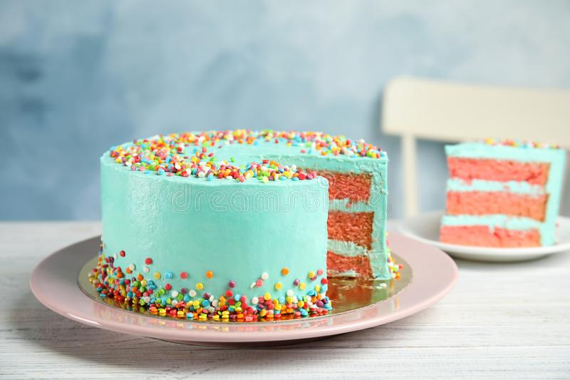 Cut fresh delicious birthday cake royalty free stock photography