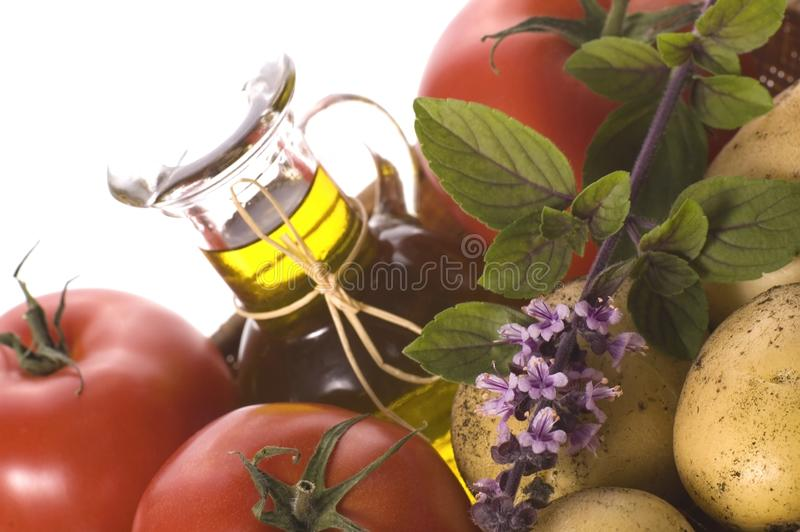 Cut fresh herbs and vegetables royalty free stock image