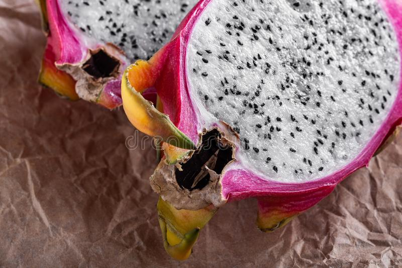 Cut fresh pitahaya on craft paper stock image