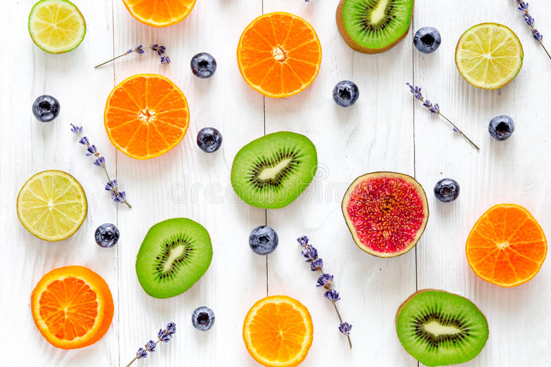 Cut fruit design with blueberry and lavender on white background top view pattern royalty free stock photography