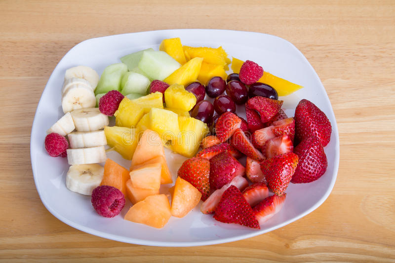 Cut Fruit with Mangos Bananas Berries Melons and Pineapple royalty free stock photos