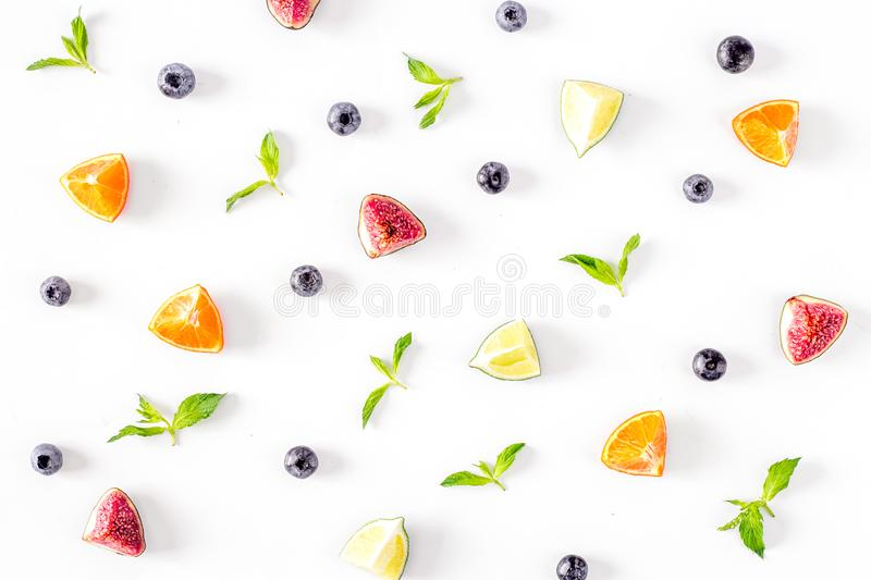 Cut fruit pattern with mint on white desk background top view royalty free stock photo