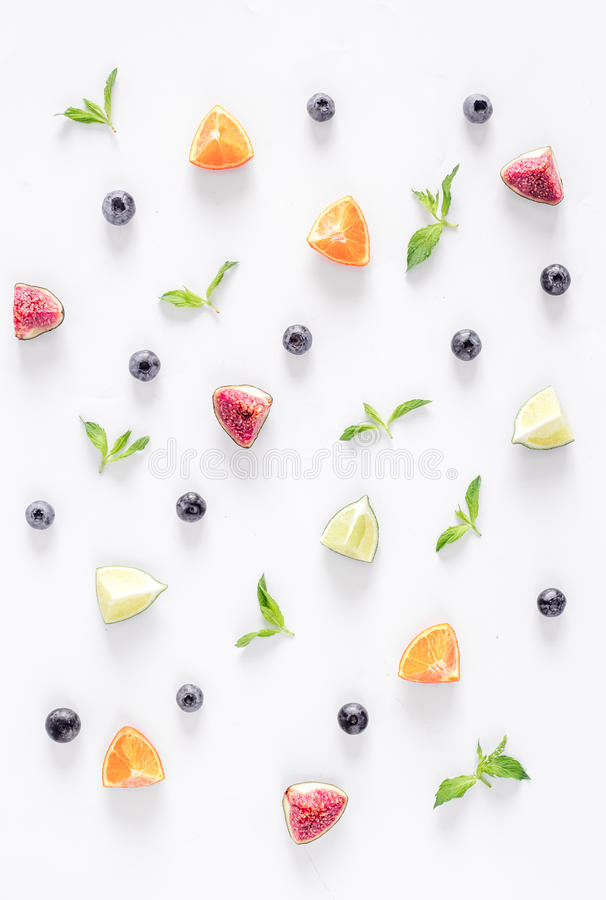 Cut fruit pattern with mint on white desk background top view stock photos