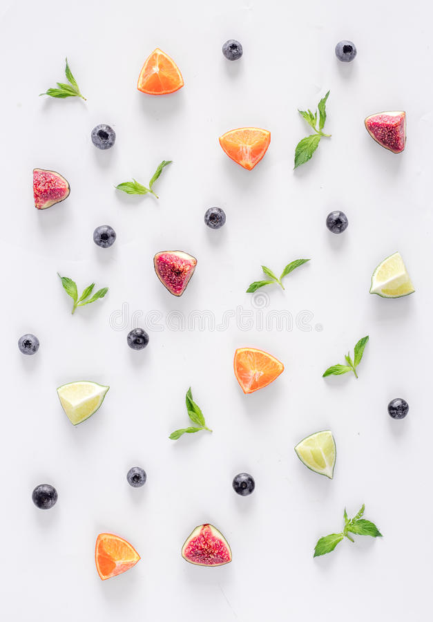 Cut fruit pattern with mint on white desk background top view royalty free stock image