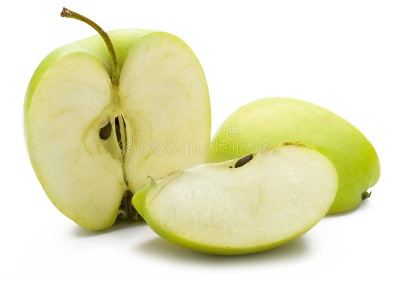 Cut Green Apple. A closeup of a cut green apple isolated on a white background royalty free stock images