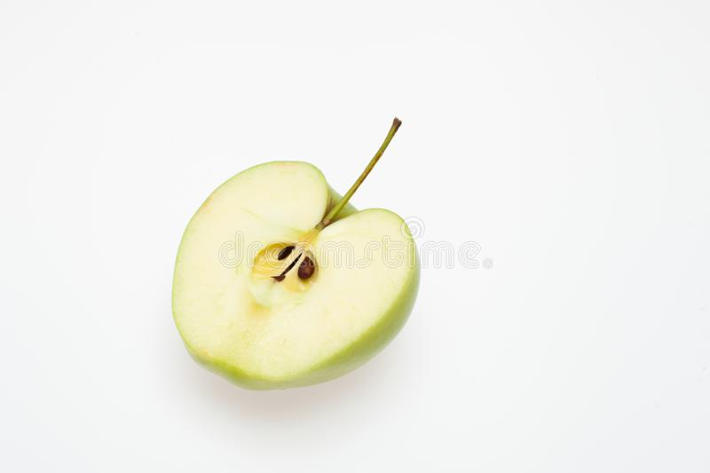 Cut green Apple on white background isolated. Background image of green Apple on white stock photo