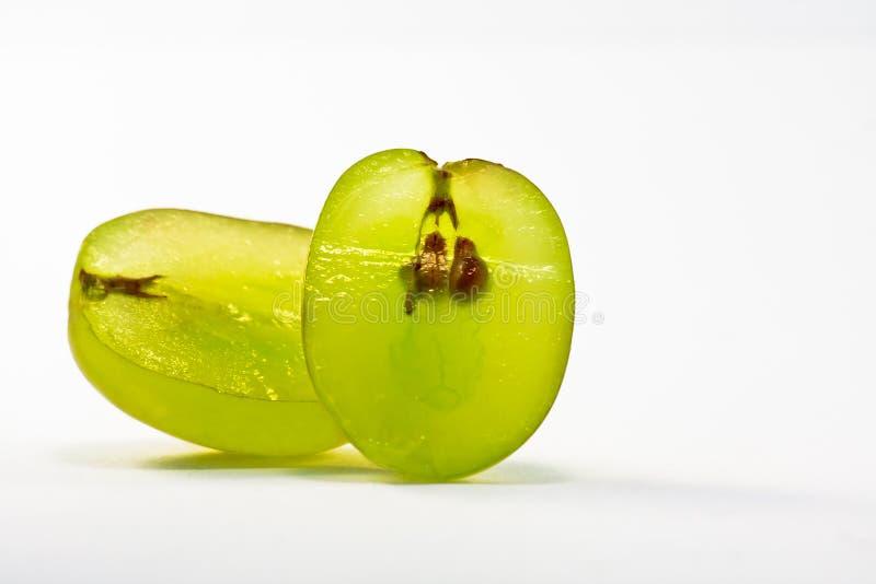 Cut green grape royalty free stock photography