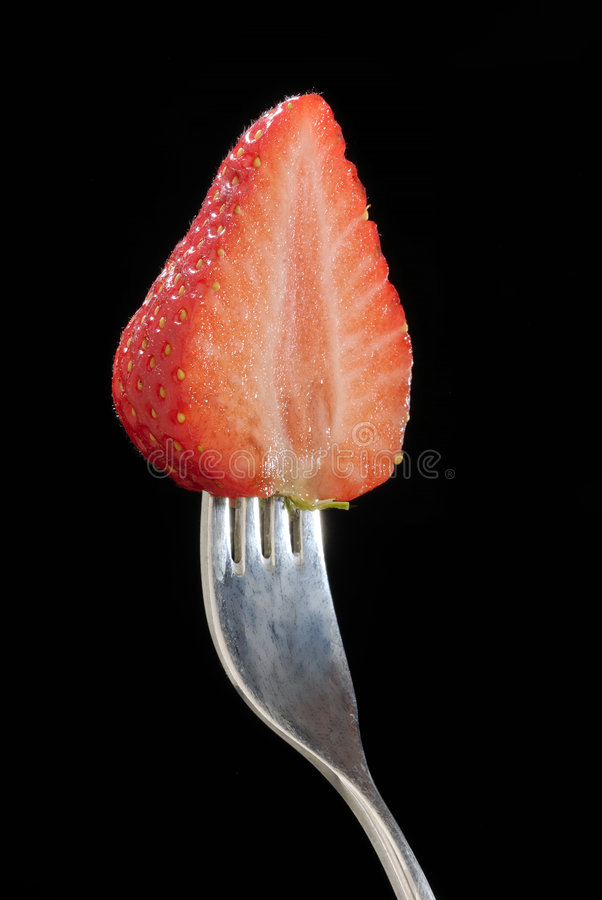 Cut half strawberry royalty free stock photos
