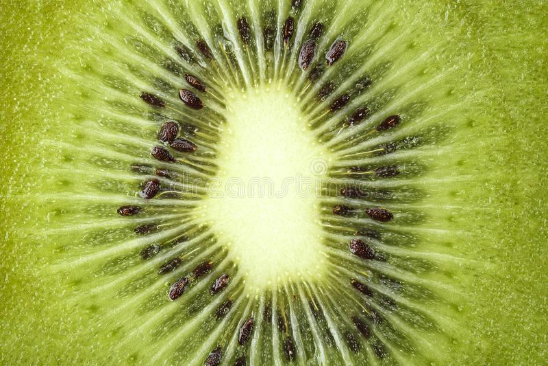 Cut kiwi closeup. Cut on halves of kiwi close-up. well visible texture of fruit royalty free stock photography