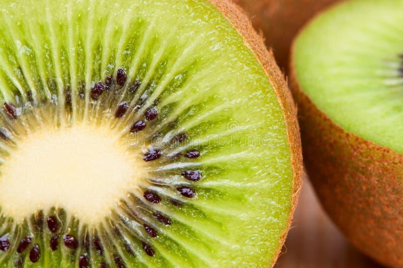 Cut kiwi closeup, macro picture stock image